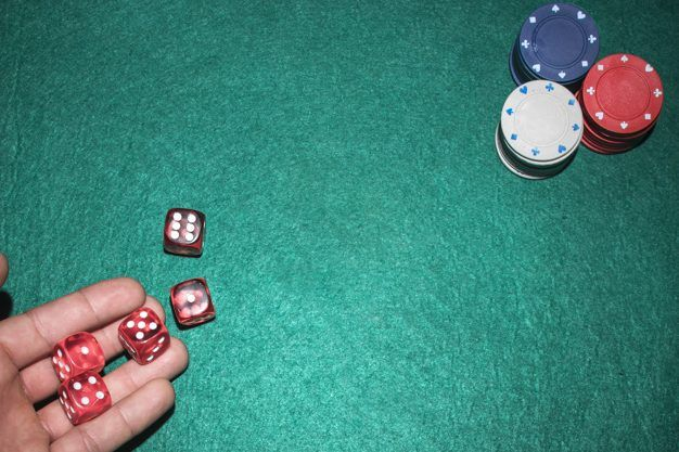poker-player-s-hand-throwing-red-dices-poker-table_23-2147881189-e1557829185784.jpg